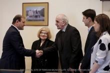 Yerevan Mayor Taron Margaryan handed the keys to new flats to Artavazd Peleshyan and to Narek Hakhnazaryan